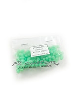 Pärlor gröna självlysande 5x7mm -100 pack
