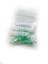 Pärlor gröna självlysande 6x8mm -20 pack