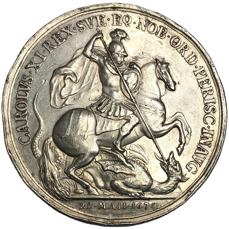 Karl XI 1660-1697, Silvermedalj 1671, osignerad av J. Roettiers utgiven till minne av utdelandet av Strumbebandsordern och dess inskrivning i ordensmatrikeln den 29 maj 1671