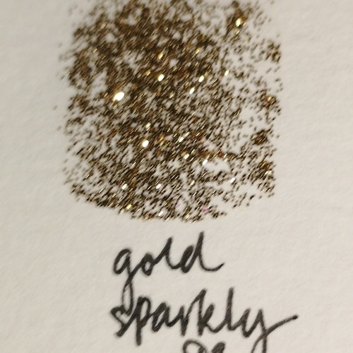 No 93 gold sparkly