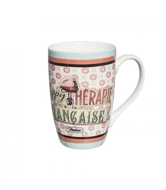 rosa och vit kaffemugg med en elvisp som bild och texten happy therapie.