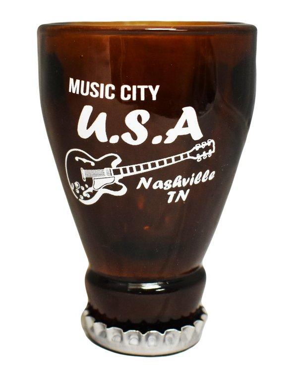 Snapsglas av en flaska uppochner, brun Nashville.