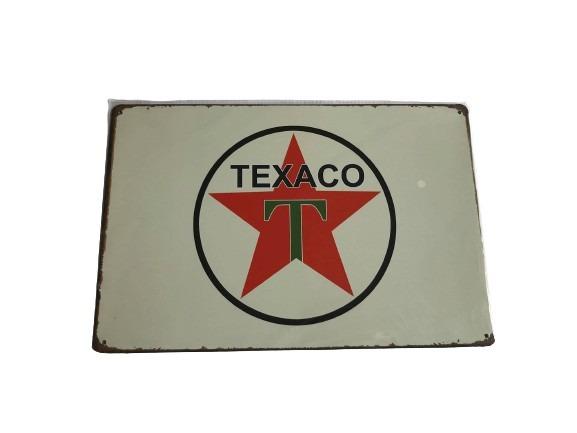 Plåtskylt med Texaco loggan på.