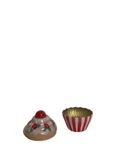 Plåtburk i form av en muffins, röda rosor och röda ränder.