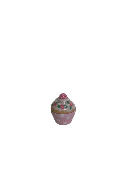 En muffins i plåt som fungerar som en liten burk, rosa.