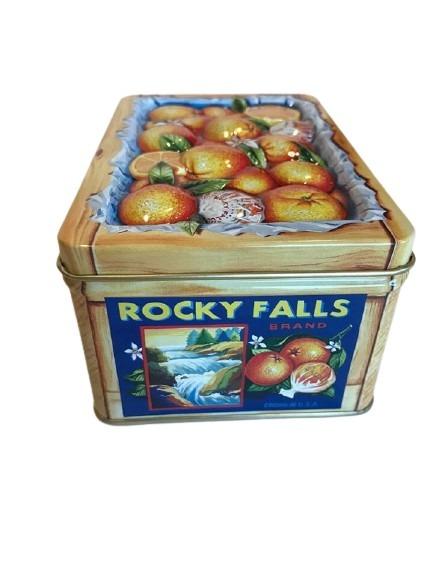 Fruktlåda i plåt med motiv av apelsiner.