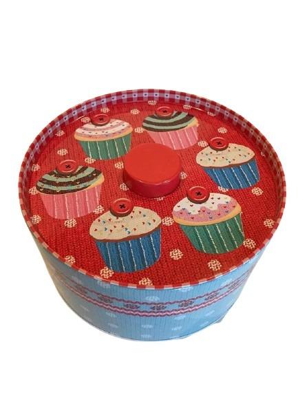 Rund burk i plåt med muffins på, röd och blå.