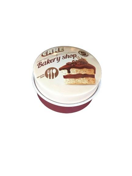 Mini plåtburk med tårtbit som motiv på locket, brun och beige.
