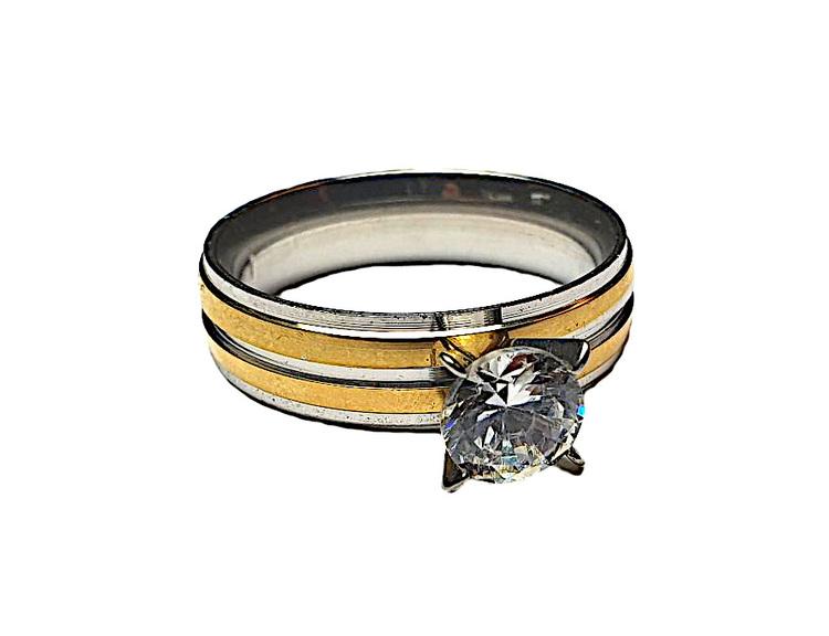 Guld och silverfärgad ring