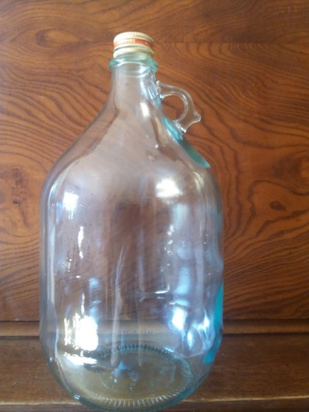 5 LITERS GLAS FLASKA  MED HANDTAG  ( BEGAGNAT  )
