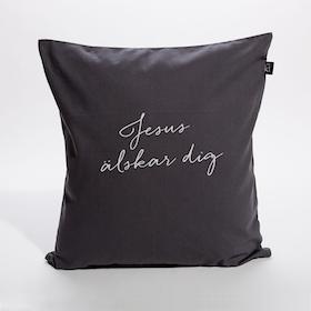 Grått kuddfodral i bomullscanvas med texten: Jesus älskar dig