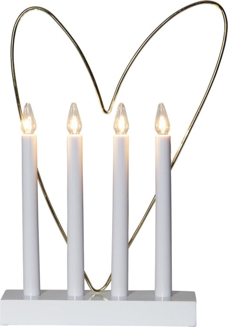 Adventsljusstake med hjärta - finns i Kristna designbutiken.