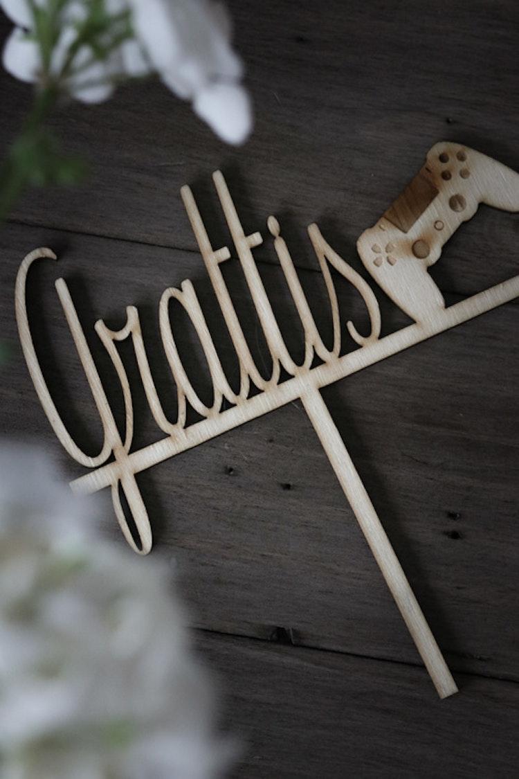 """Caketopper """"Grattis + valfritt motiv"""""""