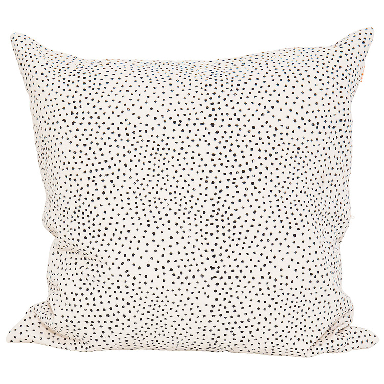 Afro art Fleck cushion cover in soft cotton with small black dots on off-white.