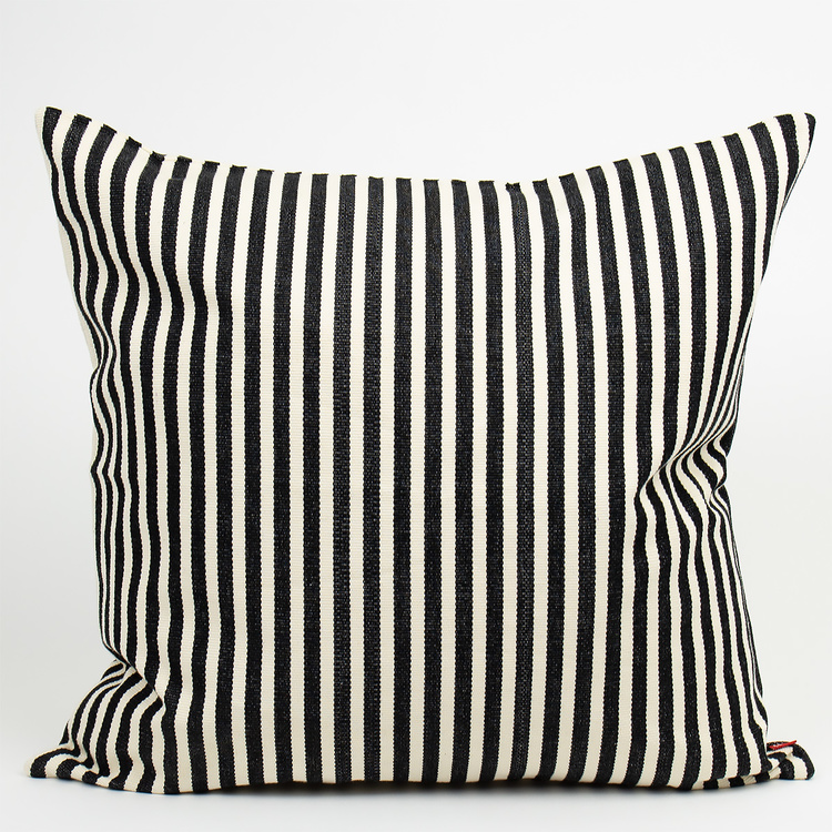 Cushion cover Donia from Afro Art, made from a sturdy hand-woven cotton quality with thin black stripes on off-white.