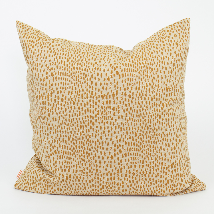 Afro art Storm cushion cover in soft cotton with ocra yellow dots on off-white.