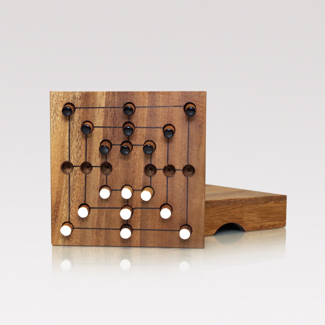 A small, handmade board game made from teak. Square, 11x11 cm with lid and black and white wooden pegs.