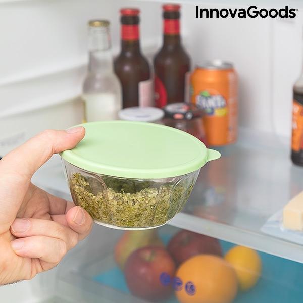Grönsakshackare med behållare att förvara i kylen