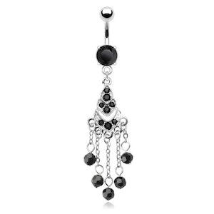 Navelpiercing med svarta pärlor