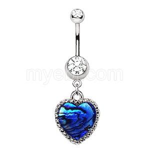 Navelpiercing med skimrande blått hjärta