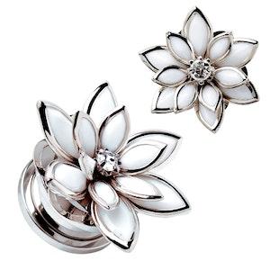 Plugg med vit blomma