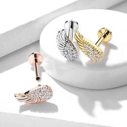 Labret piercing med änglavinge