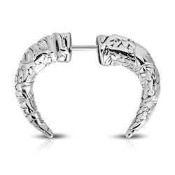 Septum horn piercing