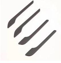 Carbon fibermönstrade stickers till dörrhandtagen på Tesla Model 3
