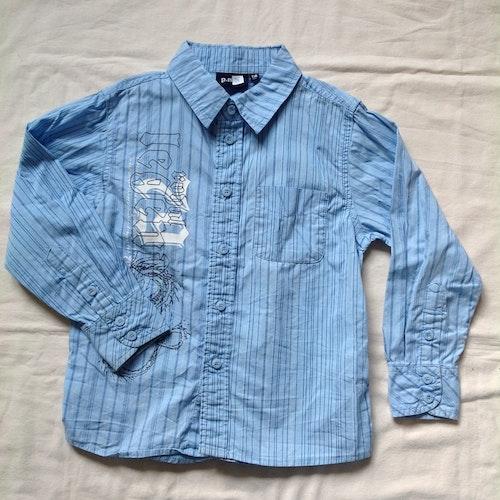 Blå skjorta stl 116