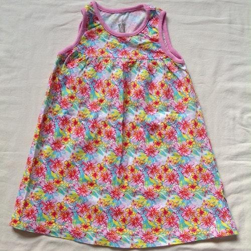 Blommig klänning stl 86