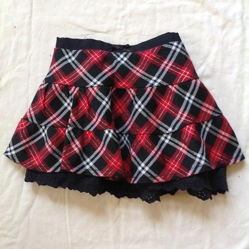 Rödrutig kjol stl 86