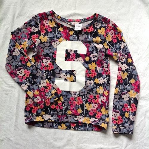 Blommig tröja stl 146/152