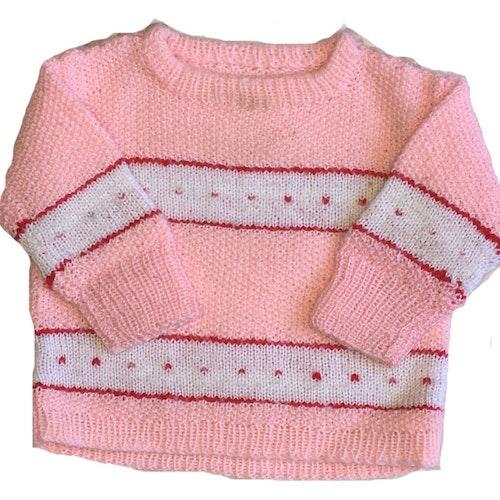 Rosa stickad tröja stl 68