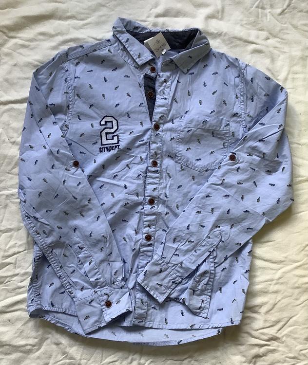 Blå skjorta stl 152