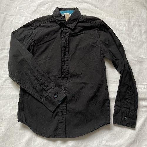 Svart skjorta stl 134