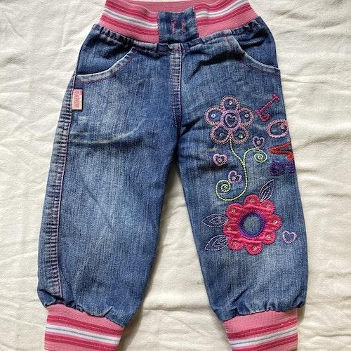 Jeans med blommor stl 80