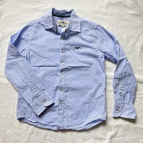 Blårandig skjorta stl 134