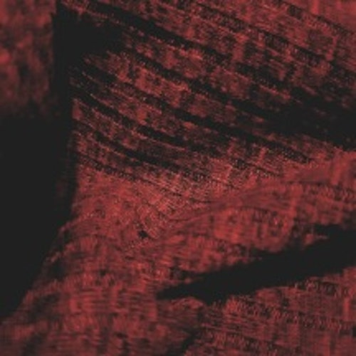 Ribbstickat vinrött tyg