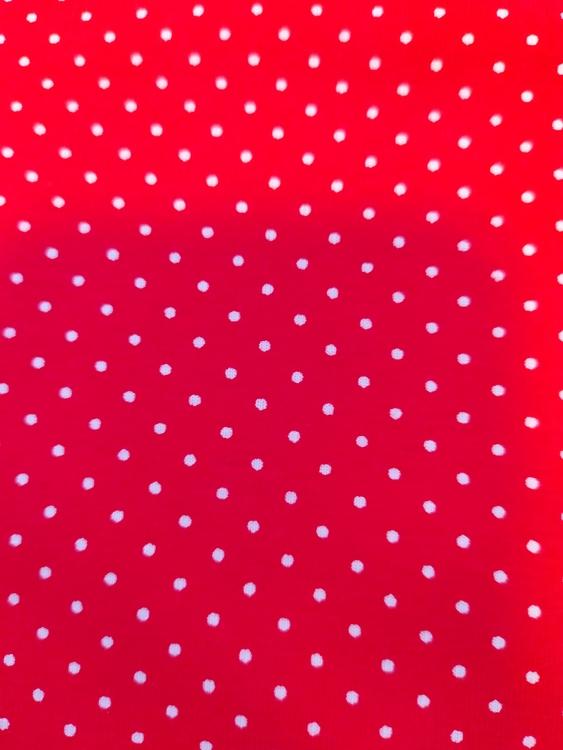 Röd prickig trikå