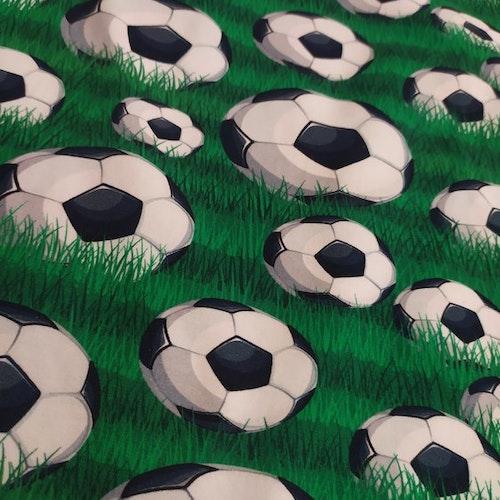 Bomullstrikå - Fotbollar på gräs