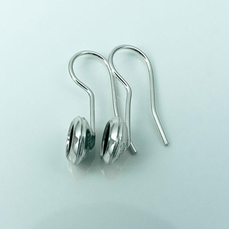 Silver örhängen med oxidering
