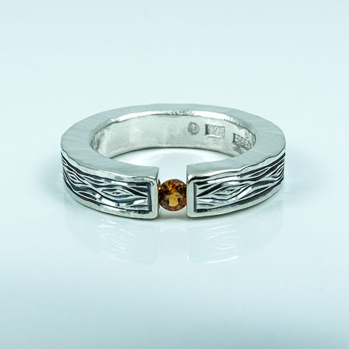 Flowing Bark silver ring with an Orange Sapphire