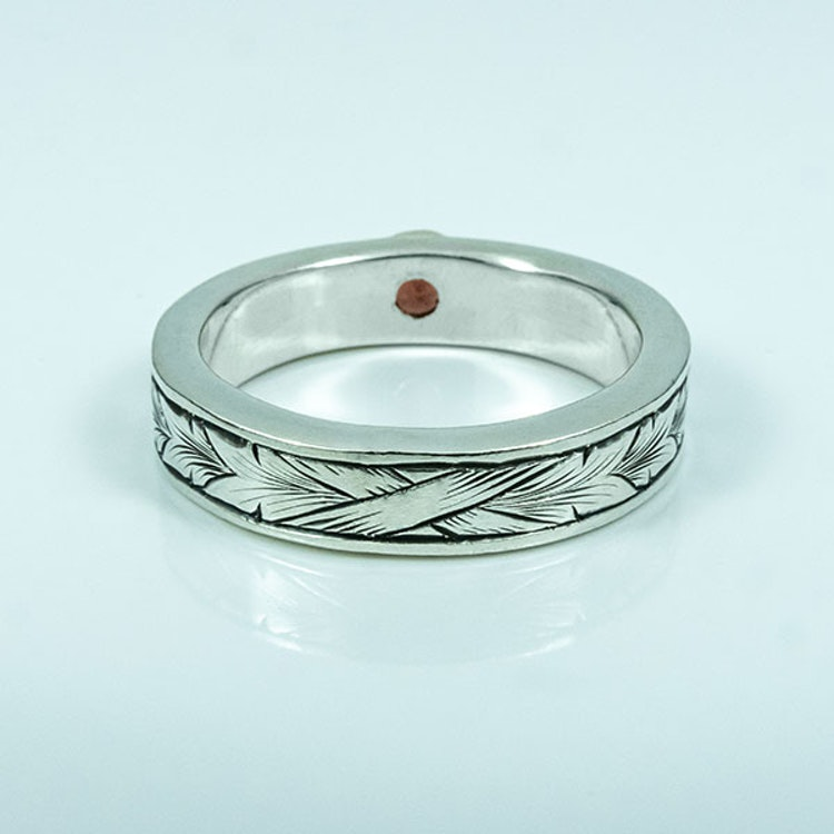 Running Leaf silver ring with a Garnet