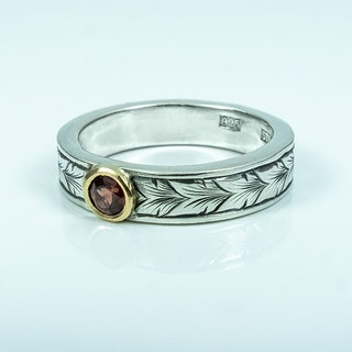 Running Leaf silver ring with a Garnet