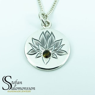 Hand-engraved lotus pendent in silver with a tourmaline