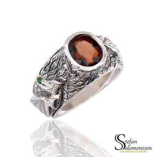 Silver dragon ring with garnets