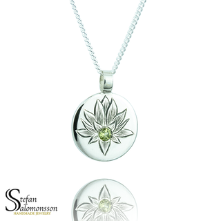 Hand-engraved lotus pendent in silver with a peridot