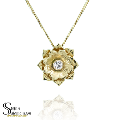 Gold lotus pendant with a diamond