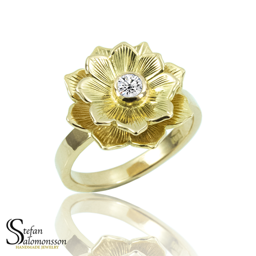 Gold lotus ring with a diamond