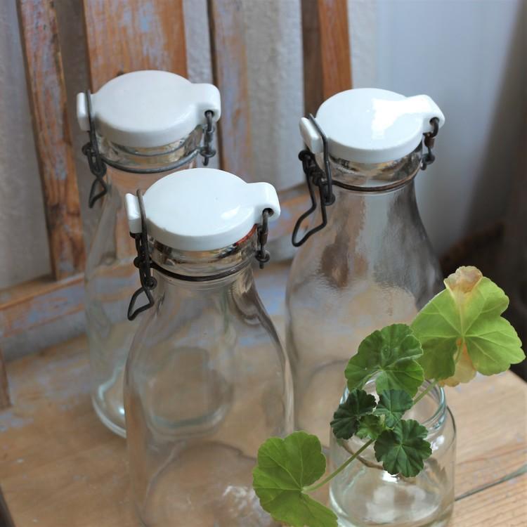Flaska - 1l Mjölkflaska med Vitt Porslinslock